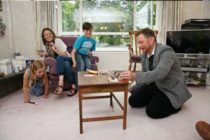 magician impressing family at a home in hertfordshire